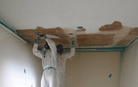Men removing asbestos safely